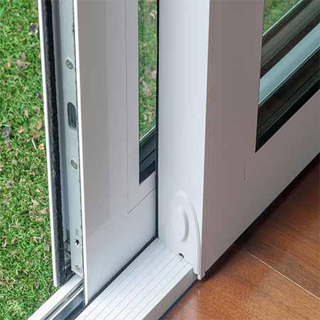 Triple track sliding glass doors