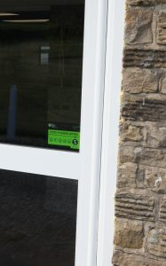Anti-finger trap on a commercial door in Derbyshire